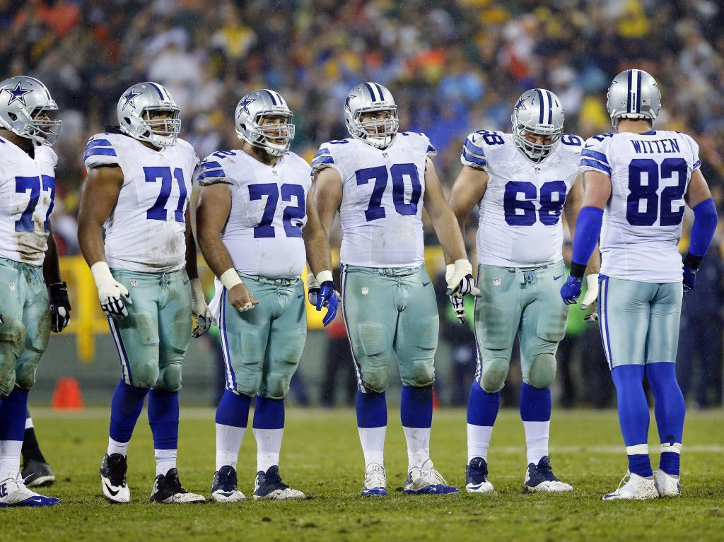 The Dallas Cowboys offensive line including, tackle Tyron Smith (77), offensive guard La'el Collins (71),  center Travis Frederick (72), guard Zack Martin (70), tackle Doug Free (68) and tight end Jason Witten (82) wait for play to resume during a timeout against the Green Bay Packers in the second half at Lambeau Field in Green Bay, Wisconsin, Sunday, December 13, 2015. The Cowboys lost, 28-7.  (Tom Fox/The Dallas Morning News)