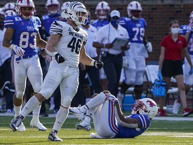 SMU wide receiver Reggie Roberson Jr. lies on the ground after suffering an injury during the second half of a game against Memphis at Ford Stadium on Saturday, Oct. 3, 2020, in Dallas.