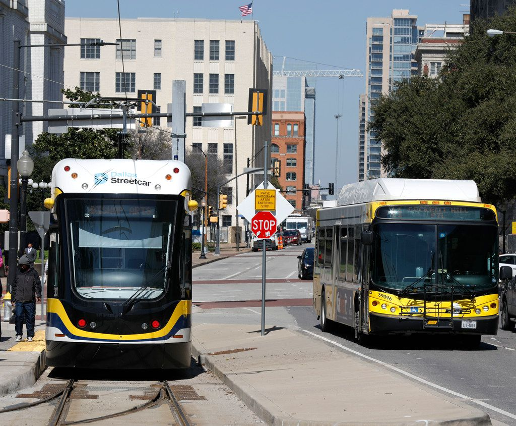 The Dallas Streetcar waits for passengers at Houston and Young Streets as a DART bus makes its way across the Houston Street viaduct to Oak Cliff out of downtown Dallas Feb. 26, 2018. (David Woo/The Dallas Morning News)