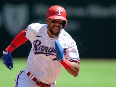 Texas Rangers' Leody Taveras (3) runs to third on a single hit by Charlie Culberson during the second inning of a baseball game against the Toronto Blue Jays, Wednesday, April 7, 2021, in Arlington, Texas. Texas won 2-1.