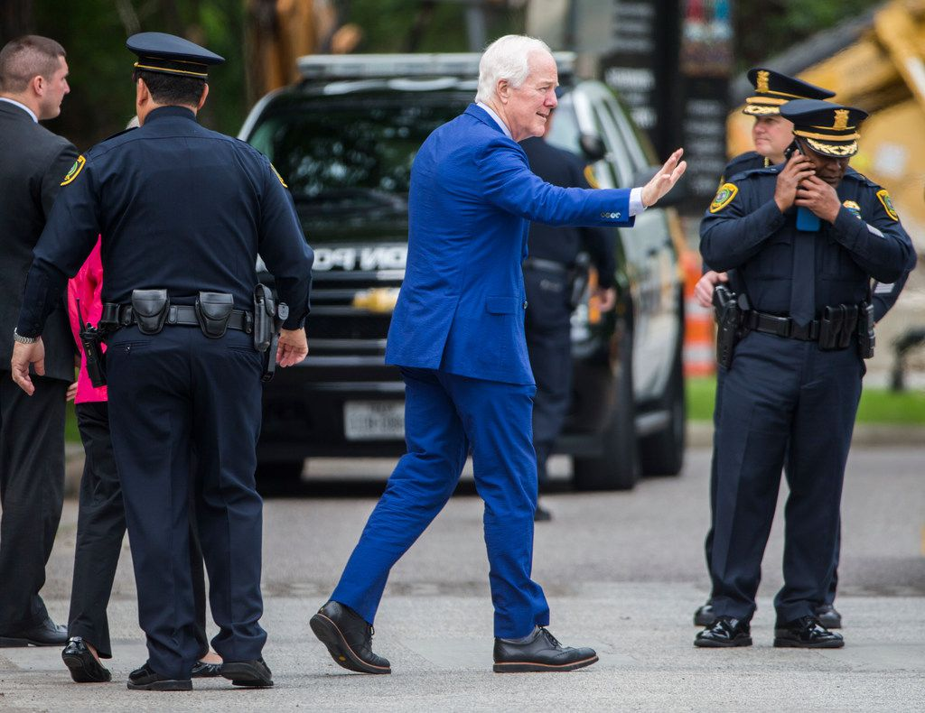U.S. Senator John Cornyn greets police officers outside St. Martin's Episcopal Church, where funeral services will be held for former first lady Barbara Bush, on Friday, April 20, 2018 in Houston. Bush died on Tuesday and her funeral services are on Saturday. (Ashley Landis/The Dallas Morning News)