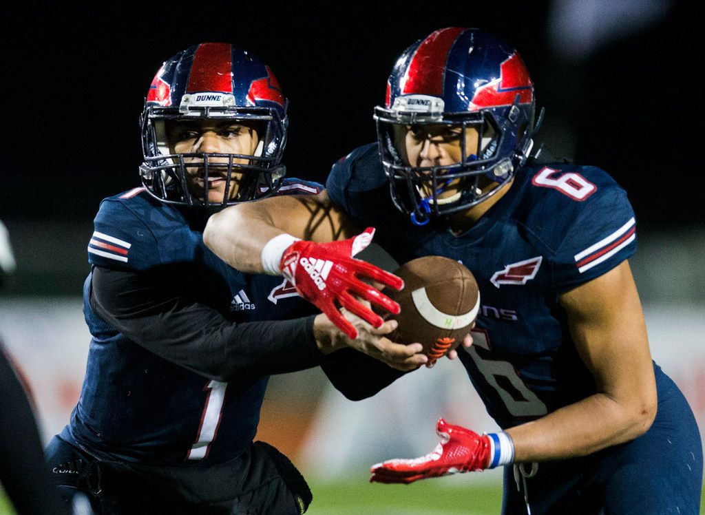 Bishop Dunne quarterback Simeon Evans (1) hands off the ball to offensive back Jaden Hullaby (6) during the third quarter of the TAPPS Division I state football championship game between Bishop Lynch and Bishop Dunne on Friday, December 7, 2018 at Midway ISD's Panther Stadium in Waco, Texas. (Ashley Landis/The Dallas Morning News