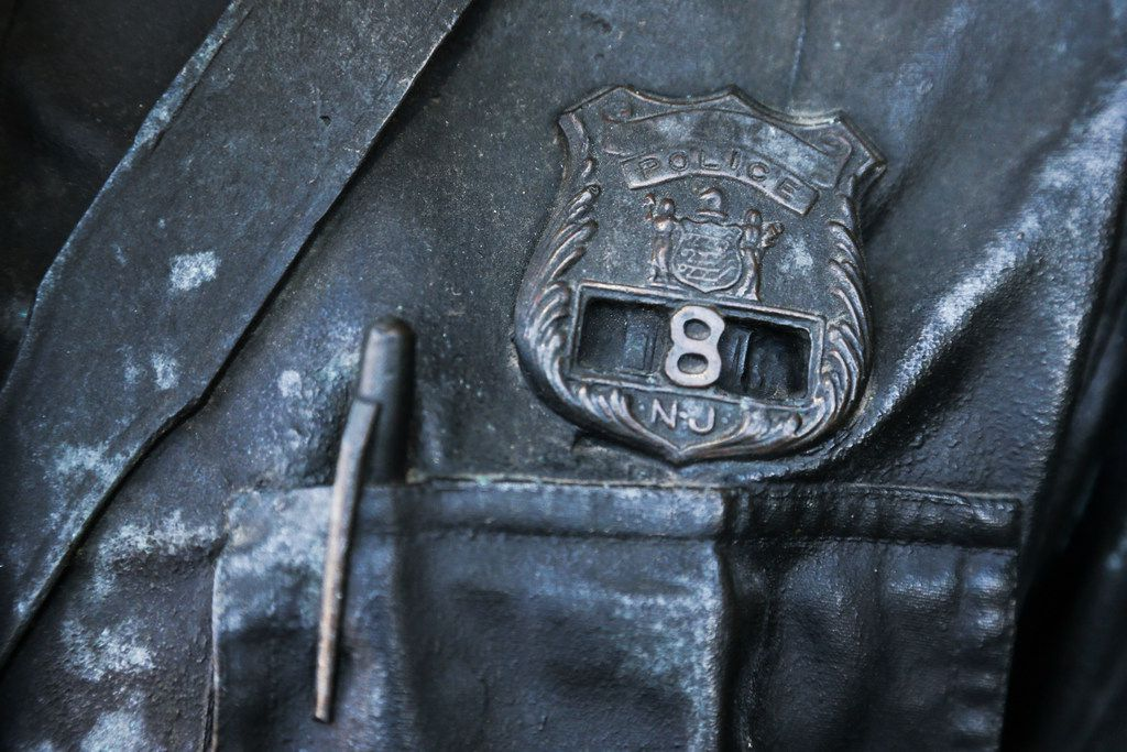 The bronze cop wears a New Jersey badge.