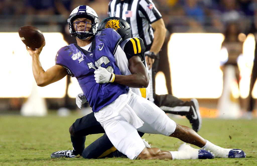 TCU Horned Frogs quarterback Alex Delton (16) throws from his knees as he tackled by a Arkansas-Pine Bluff Golden Lions defender during the second quarter at Amon G. Carter Stadium in Fort Worth Texas, Saturday, August 31, 2019. Delton was ruled down. (Tom Fox/The Dallas Morning News)