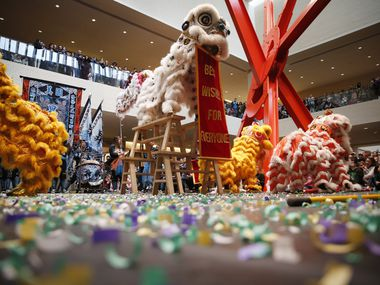 Members of the Rising Phoenix Lion Dance Association perform at last year's Chinese New Year Festival at NorthPark Center. Officials announced that the 2020 festival, hosted by the Crow Museum of Asian Art, would be 'postponed' indefinitely in connection with the ongoing coronavirus crisis in China. (Rose Baca/Staff Photographer)