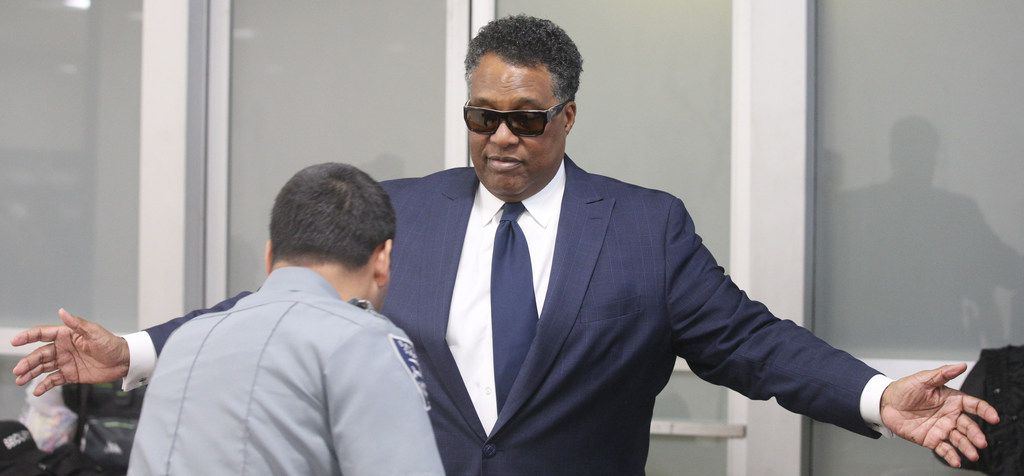 Dwaine Caraway arrives at the Earle Cabell Federal Building for sentencing. Caraway had resigned after pleading guilty to accepting $450,000 in bribes and kickbacks in the Dallas County Schools bus scandal.