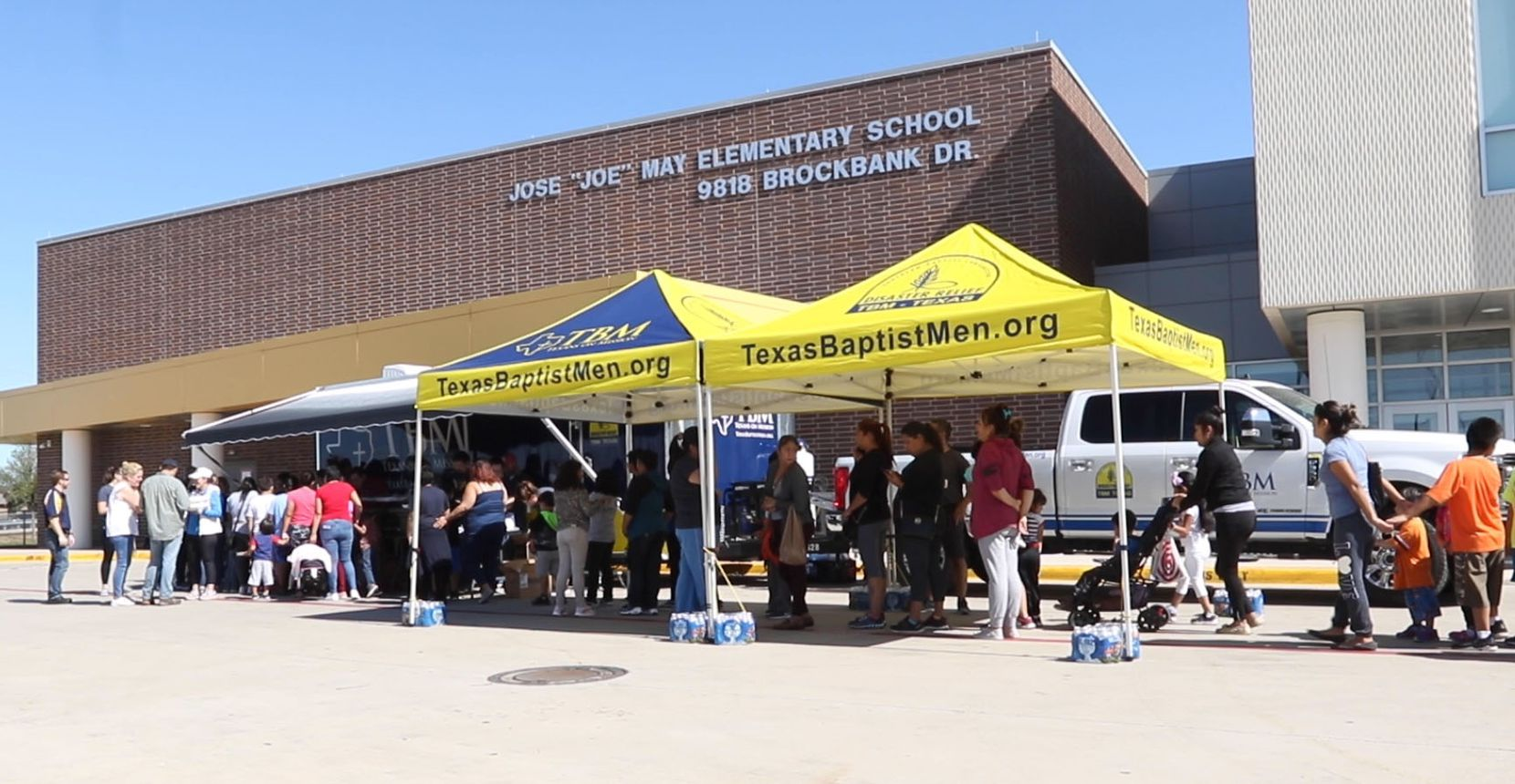 About 250 people showed up Tuesday afternoon at Joe May Elementary for a hot meal. Power outages in the area have been limiting families to fast food options.