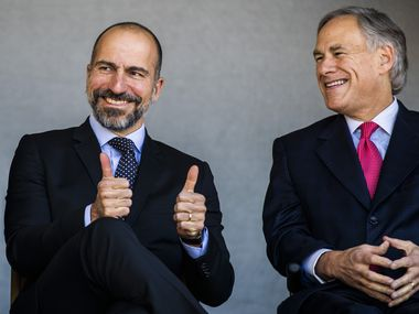 Uber CEO Dara Khosrowshahi gives a thumbs up next to Governor Greg Abbott at a ground breaking ceremony for a new Uber Deep Ellum office on Friday, November 1, 2019 in Dallas. (Ashley Landis/The Dallas Morning News)