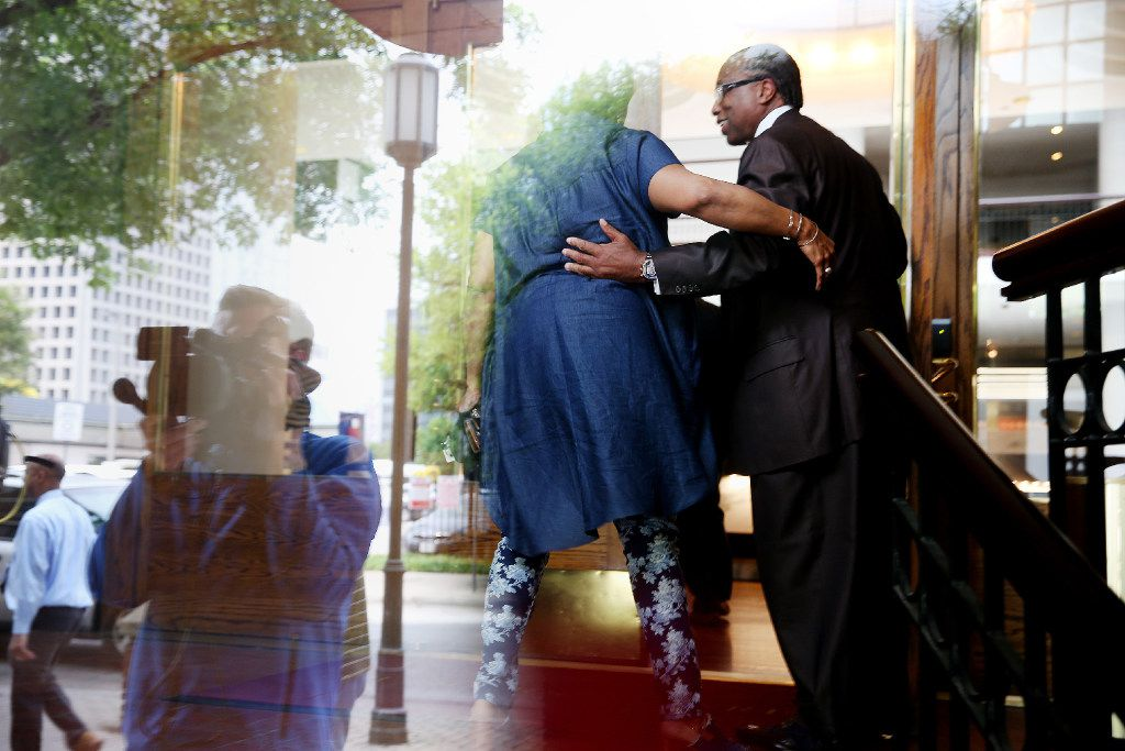 Dallas County Commissioner John Wiley Price is greeted after entering Founders Square offices after being found not guilty of seven counts during his federal corruption trail in Dallas, Friday, April 28, 2017. On the eighth day of deliberations, the jury exonerated Price on seven charges against him and deadlocked on four tax-related counts. The judge declared a mistrial on the deadlocked charges. (Andy Jacobsohn/The Dallas Morning News)