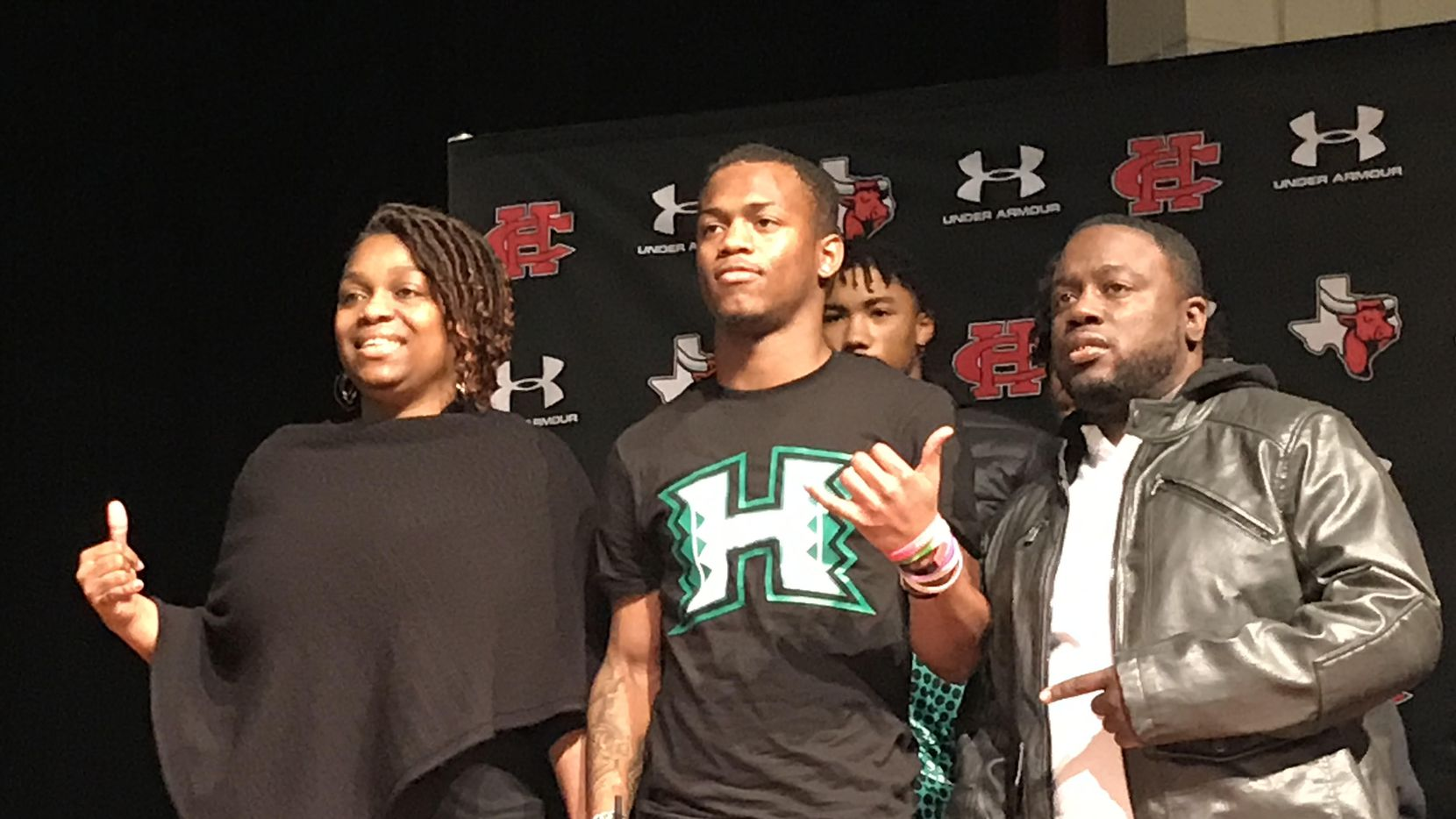 Hawaii signee Quin Bright poses for photographs during Cedar Hill's signing day ceremony on Wednesday, Feb. 5, 2020.