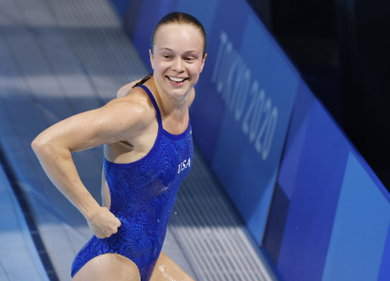 USA's Krysta Palmer is all smiles after completing her last dive in the women's 3 meter springboard final during the postponed 2020 Tokyo Olympics at Tokyo Aquatics Centre, on Sunday, August 1, 2021, in Tokyo, Japan. Palmer finished 3rd with a total score of 343.75 to earn a bronze medal. (Vernon Bryant/The Dallas Morning News)