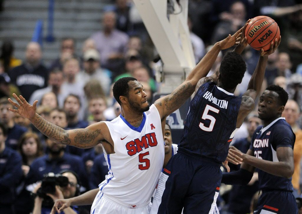 FILE - SMU's Markus Kennedy (5) defends UConn's Daniel Hamilton during the second half of the American Conference championship game in Hartford, Conn., on Sunday, March 15, 2015. (AP Photo/Fred Beckham)