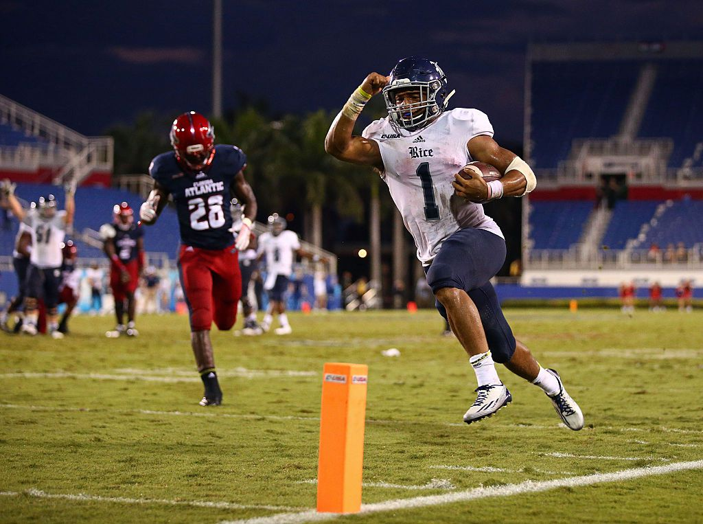 BOCA RATON, FL - OCTOBER 10: Darik Dillard #1 of the Rice Owls scores the game-winning touchdown as Alfred Ansley #28 of the Florida Atlantic Owls looks on during the fourth quarter of the game at FAU Stadium on October 10, 2015 in Boca Raton, Florida.  (Photo by Rob Foldy/Getty Images)