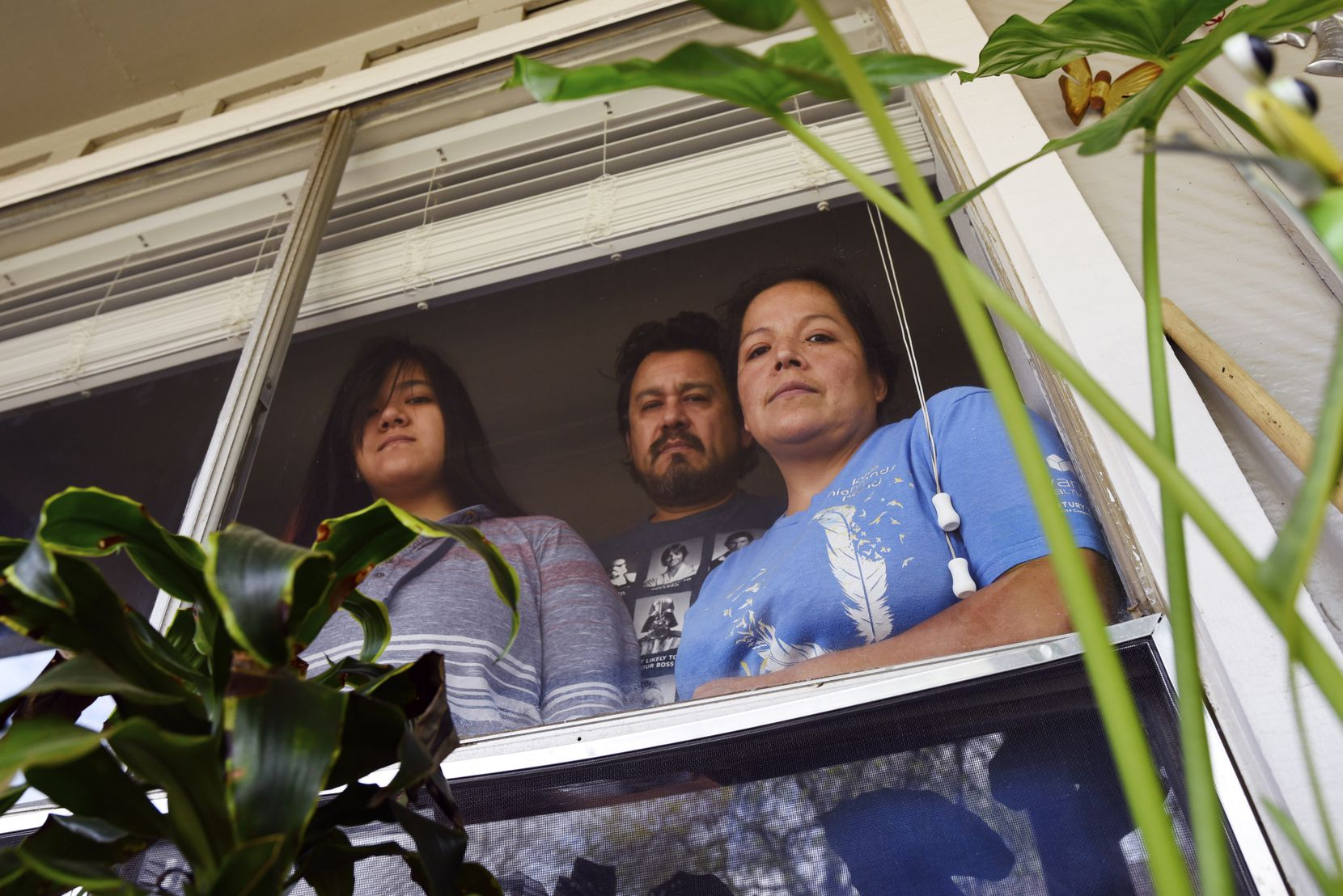 Aurora Salazar (right) is shown with husband Alberto Hernandez and one of their kids, Karina Herandez, inside their apartment in Dallas.