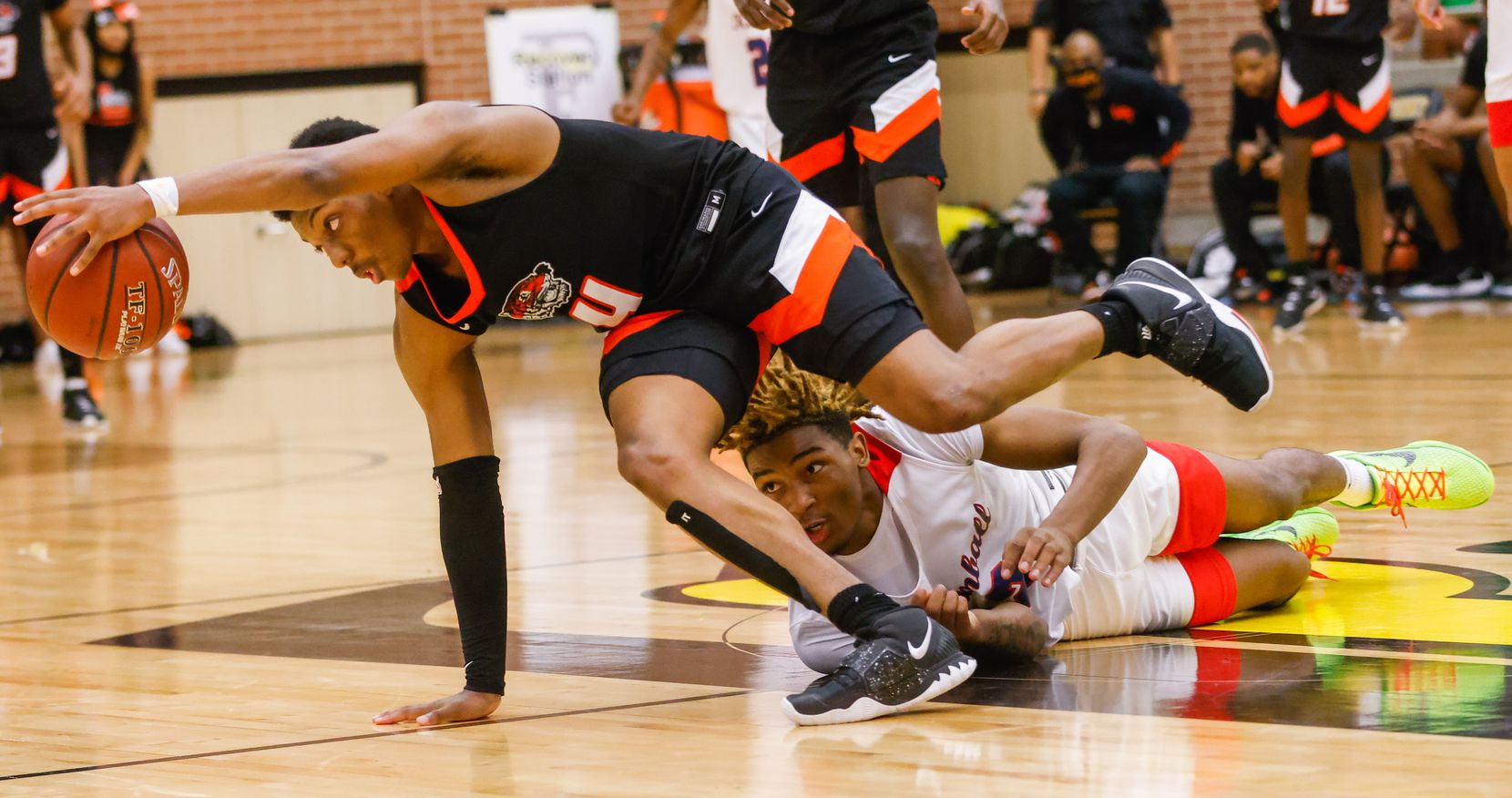 Kimball's Arterio Morris (2) chases after Lancaster's Wade Taylor IV during the overtime of a boys basketball UIL Class 5A Region II playoff game in Forney on Friday, March 5, 2021. (Juan Figueroa/ The Dallas Morning News)
