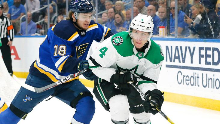 Dallas Stars defenseman Miro Heiskanen (4) controls the puck from St. Louis Blues center Robert Thomas (18) during the second period at the Enterprise Center in St. Louis, Tuesday, May 7, 2019.