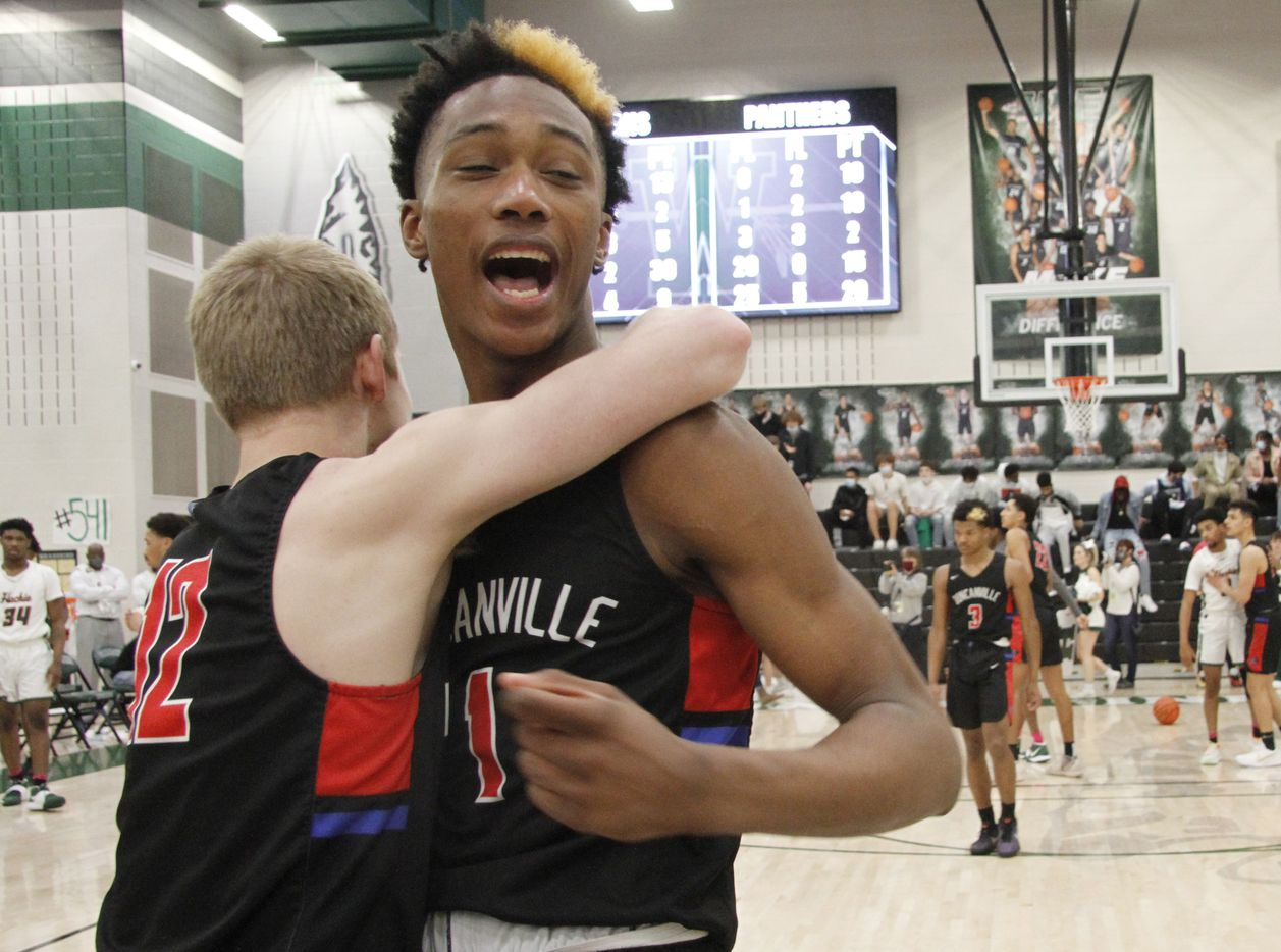 Duncanville's Ronald Holland (1), right, and teammate Jackson Prince (12) celebrate at mid-court following the Panthers' 70-65 victory over Waxahachie to advance. The two teams played their Class 6A Region ll boys final  playoff basketball game at Waxahachie High School in Waxahachie on March 5, 2021. (Steve Hamm/ Special Contributor)