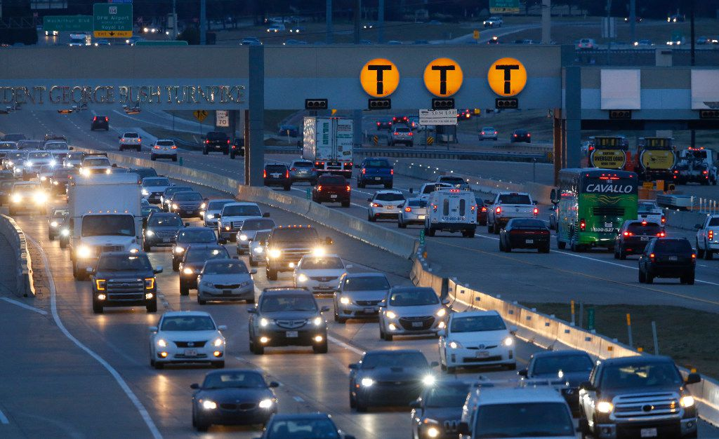 Cars pass through the automated NTTA toll station on the Bush Turnpike during rush hour in Irving.