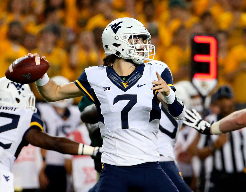 FILE - West Virginia quarterback Will Grier (7) winds up to throw the ball during the first half of a game against Baylor on Oct. 21, 2017, in Waco. (AP Photo/Jerry Larson, File)