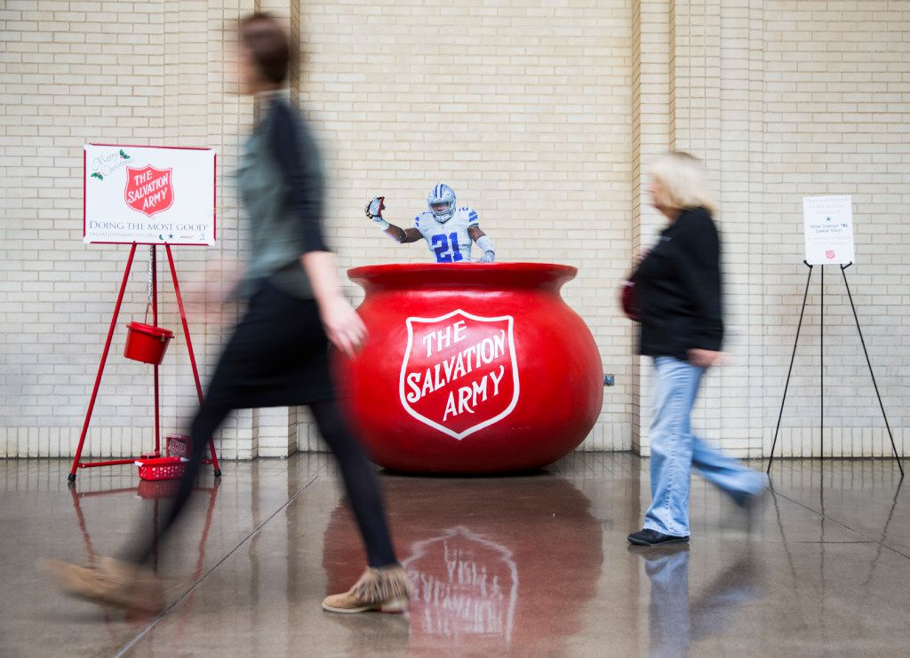 "A tiny cut out version of Ezekiel Elliott mimics a ""bell ringer"" inside the Salvation Army red kettle that Dallas Cowboys running back Ezekiel Elliott (21) jumped into during Sunday's game against the Tampa Bay Buccaneers is displayed in North Park Center on Wednesday, December 21, 2016 in Dallas. It was placed in the mall so shoppers could take photos for a suggested $21 donation. (Ashley Landis/The Dallas Morning News)"