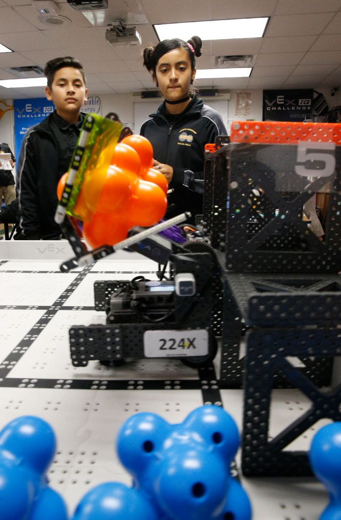 Abelino Graciano, 11, (left) and Keyri Fernandez, 11, use Wildbot to move around modules for points during  robotics club at Winnetka Elementary in Dallas on May 26, 2017.