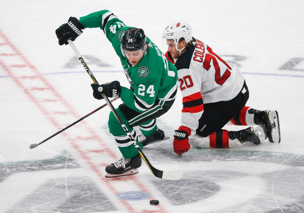 FILE - Stars left wing Roope Hintz (24) steals the puck from Devils center Blake Coleman (20) during the third period of a game on Tuesday, Dec. 10, 2019, at American Airlines Center in Dallas.