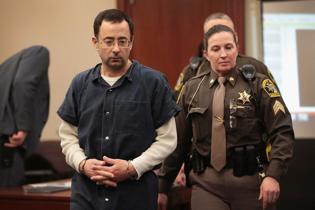 Larry Nassar appears in court to listen to victim impact statements after being accused of molesting girls while he was a physician for USA Gymnastics and Michigan State University. Nassar pleaded guilt in Ingham County, Mich., to sexually assaulting seven girls.
