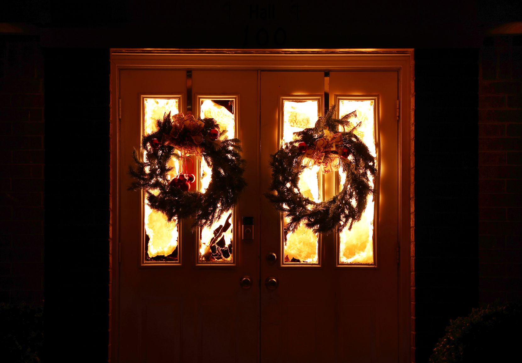 Christmas wreaths hung on the doors at Anna United Methodist Church as it burned Friday.