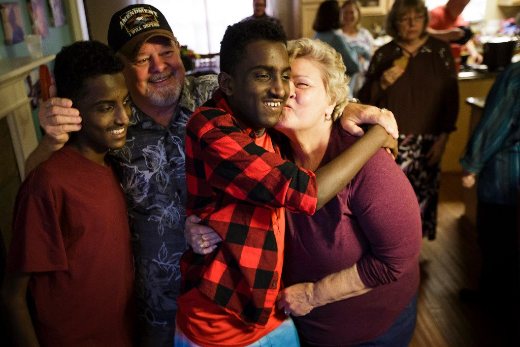 Marcos Bogale (center) gets a kiss from Linda Keylon as his twin Tamirat gets a hug from Gary Keylon during a going away party for the twins on Monday, April 24, 2017, in Plano.