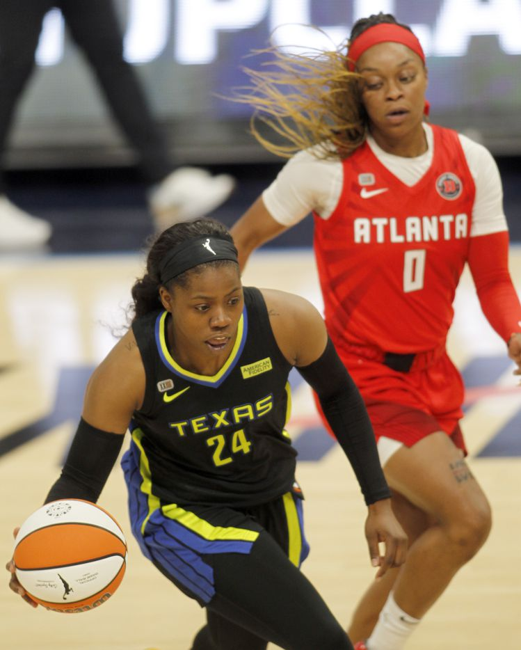 Dallas Wings guard Arike Ogunbowale (24) drives past the defense of Atlanta Dream guard Odyssey Sims (0) during first half action. The two teams played their WNBA game at College Park Center on the campus of UT-Arlington on September 5, 2021. (Steve Hamm/ Special Contributor)