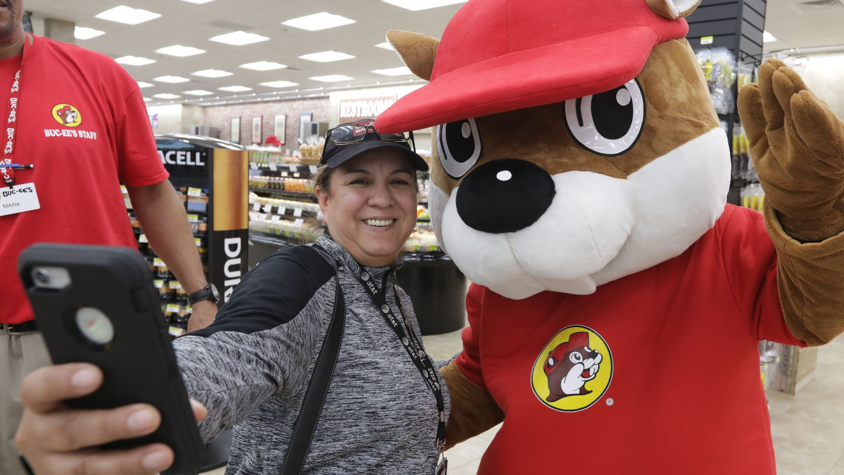 Tania Cortez takes a selfie with the Buc-ee's beaver mascot at the new Buc-ee's in Melissa, TX, on Apr. 29, 2019. The Melissa location is Buc-ee's fourth travel center in North Texas, adding to the ones in Fort Worth, Terrell and Denton. One is expected to open in Royse City later in 2019, and another is planned for Ennis in 2020.