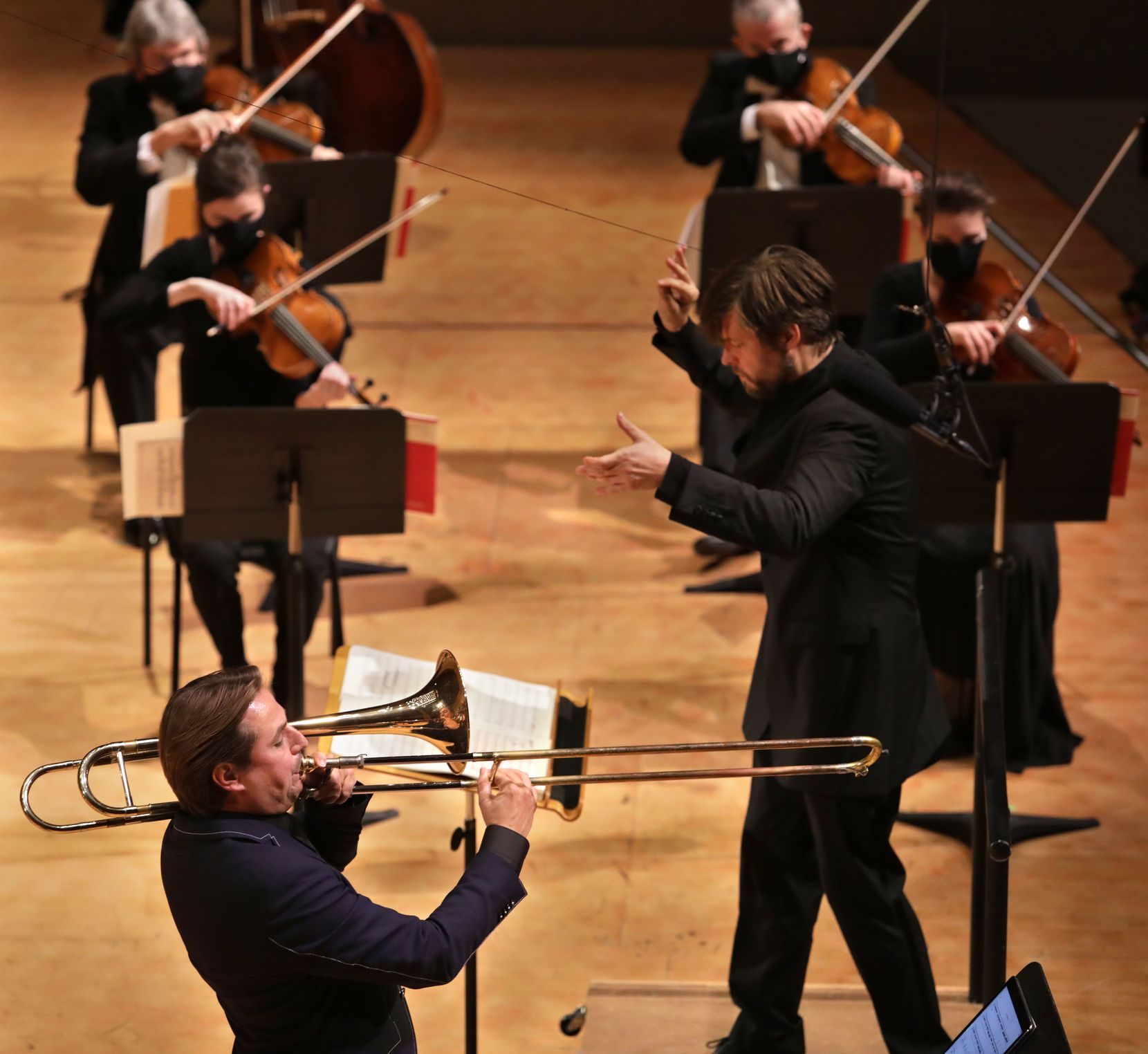 Jörgen van Rijen plays trombone as Juraj Valčuha conducts during a Dallas Symphony Orchestra performance at the Morton H. Meyerson Symphony Center on Oct. 1.
