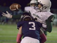 Greenhill's Jake Nelson (4) can't hold onto a pass as he is hit by Episcopal's Carter Hogg (3) in the first quarter of a high school football game between Greenhill and Episcopal School of Dallas, Friday, Oct. 23, 2020, in Dallas.
