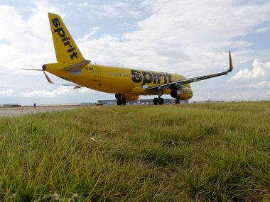 A Spirit Airlines plane taxis at DFW International Airport.