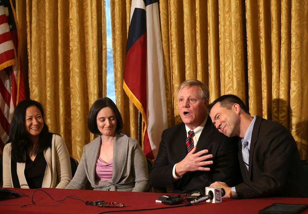 Gay couples (from left) Cleopatra DeLeon and Nicole Dimetman, and Mark Phariss and Victor Holmes, give a news conference in San Antonio on Feb. 26, 2014, after U.S. Federal Judge Orlando Garcia declared a same-sex marriage ban in deeply conservative Texas unconstitutional. (AP Photo/San Antonio Express-News, Jerry Lara)