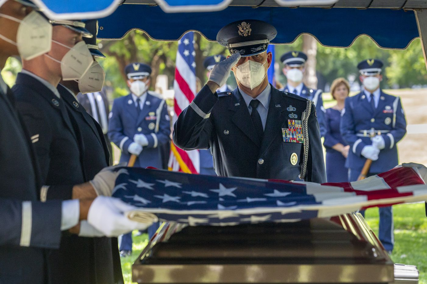 An Air Force Honor Guard member salutes during the funeral for Congressman Samuel Robert Johnson at the Restland Memorial Park in Dallas on Monday, June 8, 2020. In addition to 28 years of service as a congressional representative for Texas' 3rd District, Johnson was also a fighter pilot, decorated combat veteran and a former Prisoner of War.
