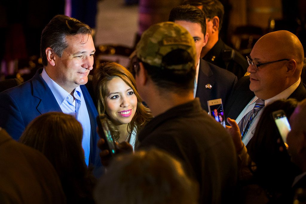 Sen. Ted Cruz poses for photos with supporters during a campaign event at River Ranch Stockyards in Fort Worth on April 4, 2018.