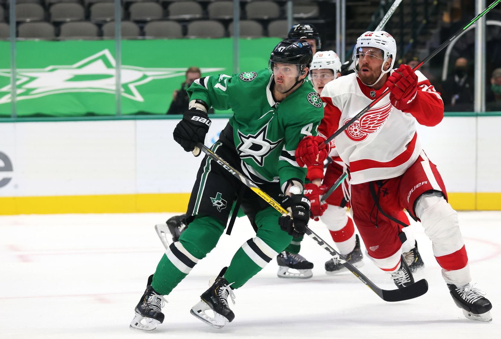 Dallas Stars right wing Alexander Radulov (47) and Detroit Red Wings defenseman Patrik Nemeth (22) fight for position during the third period of play at American Airlines Center on Tuesday, January 26, 2021in Dallas. (Vernon Bryant/The Dallas Morning News)