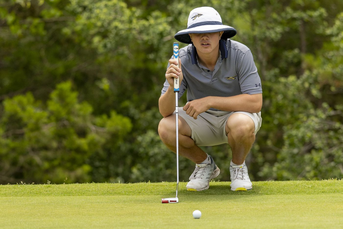 KellerÕs Kaelen Dulany studies his shot on the 14th green during the final round of the UIL Class 6A boys golf tournament in Georgetown, Tuesday, May 18, 2021. (Stephen Spillman/Special Contributor)