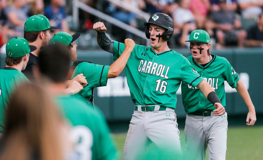Southlake Carroll's Austin Hale (16) is congratulated by teammates after scoring on a wild pitch by Flower Mound's Cam Brown, not pictured, during the first inning in game one of a best of three series Class 6A Region I final at TCU's Lupton Stadium in Fort Worth, Thursday, May 30, 2019. (Brandon Wade/Special Contributor)