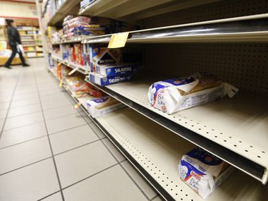 Inventory of bread in the section is low at La Michoacana Meat Market in Dallas on Saturday, March 14, 2020. Shopping for staples has increased at grocery stores due to the coronavirus.