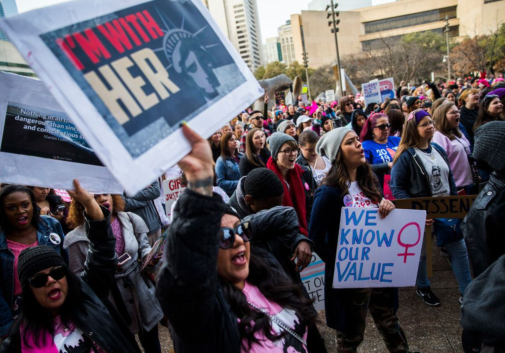 Women cheer at a rally at Dallas City Hall after the Dallas Women's March on Sunday, January 20, 2019 in downtown Dallas. People marched from St. Paul United Methodist Church to Dallas City Hall in support of women's rights. (Ashley Landis/The Dallas Morning News)