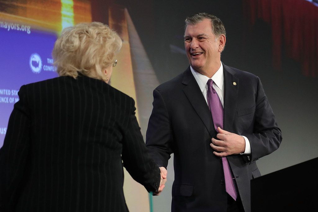 Dallas Mayor Mike Rawlings was welcomed to the stage by Las Vegas Mayor Carolyn Goodman during the U.S. Conference of Mayors 86th annual Winter Meeting at the Capitol Hilton on Jan. 25, 2018 in Washington, DC. The nonpartisan conference of mayors from cities with populations of 300,000 or larger meets annually.