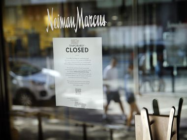 A closed sign appears on the door of Neiman Marcus' flagship store in downtown Dallas, Sunday, April 19, 2020. The department store is expected to file for bankruptcy amid the COVID-19 pandemic. (Tom Fox/The Dallas Morning News)
