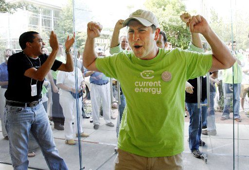 Ben Lack of Dallas celebrates as he enters the Apple Store on Knox Street in Dallas to be the customer to buy the original iPhone on June 29, 2007.