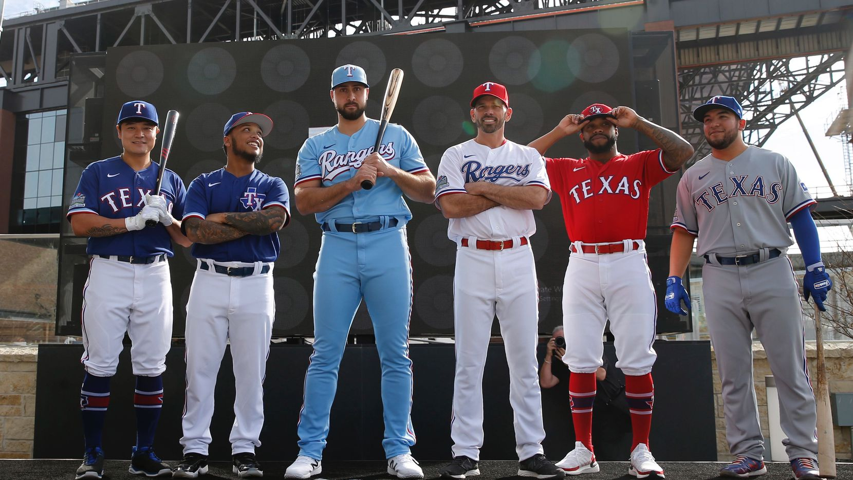 Texas Rangers Shin-Soo Choo, Willie Calhoun, Joey Gallo, Chris Woodward, Delino DeShields and Jose Trevino on stage during the unveiling of the 2020 uniforms at Live! next to Globe Life Field in Arlington, Texas on Wednesday, December 4, 2019.