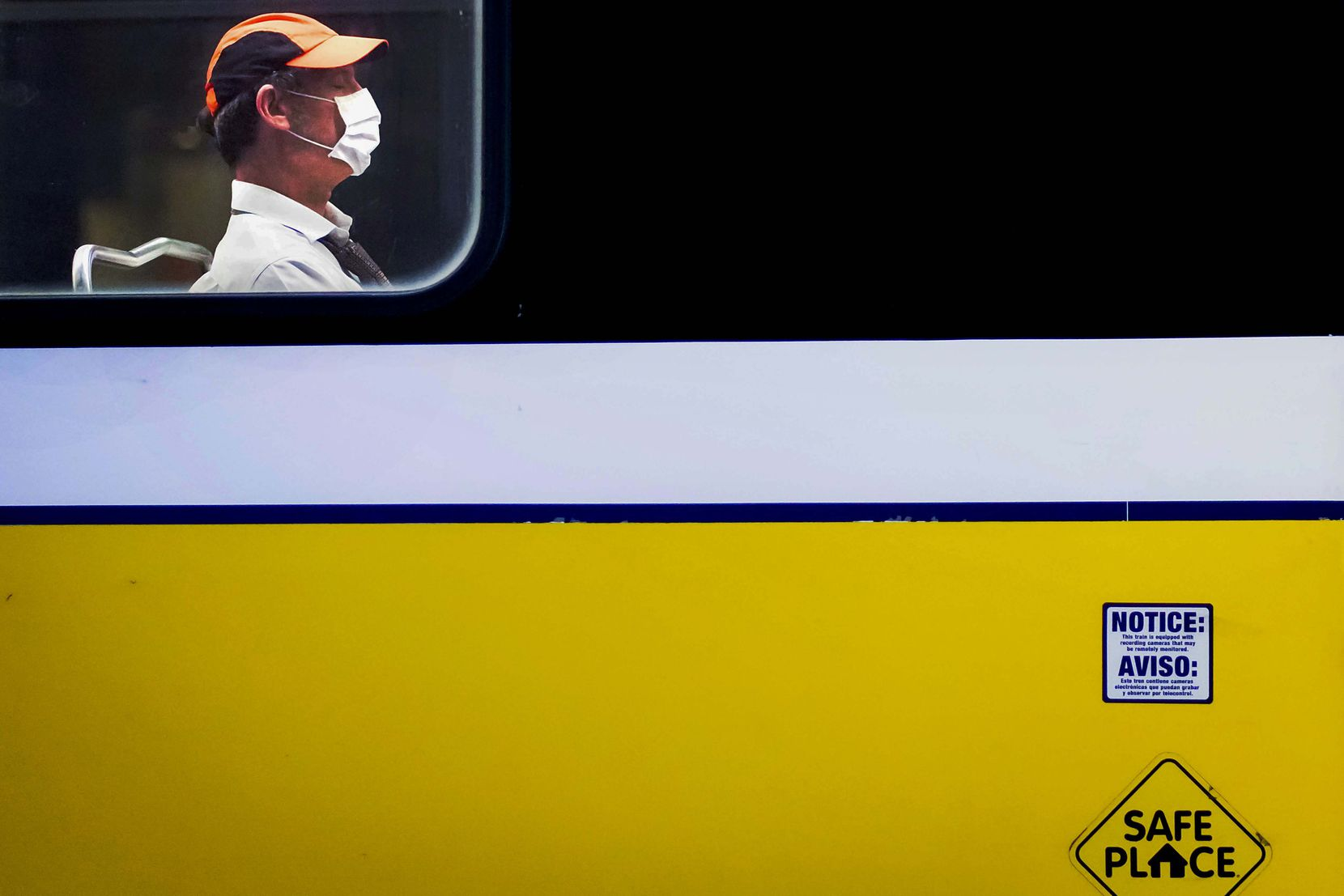 A rider wearing a face mask rode a train at the DART rail St. Paul Station in downtown Dallas on May 9, 2020. Dallas County orders require face mask be worn while using public transportation.