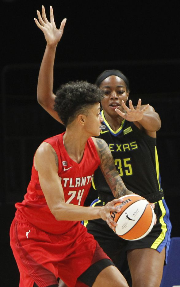 Dallas Wings forward Charli Collier (35) defends against Atlanta Dream forward Candice Dupree (24) during first half action. Dallas lost to Atlanta 69-64. The two teams played their WNBA game at College Park Center on the campus of UT-Arlington on September 5, 2021. (Steve Hamm/ Special Contributor)