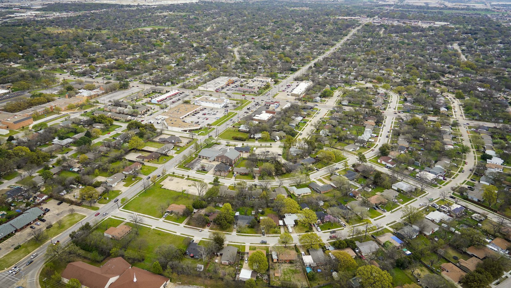 Aerial view of residential neighborhoods and retail on Thursday, March 12, 2020, in Arlington, TX.