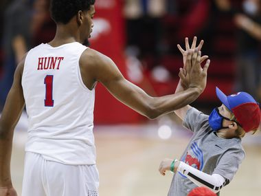 SMU forward Feron Hunt (1) high-fives a fan after a college basketball game against Memphis in Dallas, Thursday, January 28, 2021. SMU won 67-65. (Brandon Wade/Special Contributor)